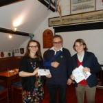 Caitland and Morgause being presented with their Junior powerboat level 2 and ICC certificates by the Commodore
