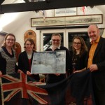 "Carl and Tracey, and Caitland and Morgause, presented the Club with a framed picture of ""Oyster Hollingsclough"".  The ensign pictured is the one taken off the yacht just before it sank."